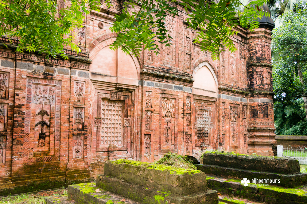 Old graves outside the decorated wall of Bagha Mosque, a fine example of Islamic architecture in Bangladesh