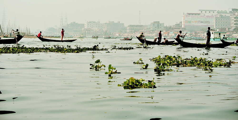 Commuting Ganges style on the river Buriganga at Old Dhaka in Bangladesh.