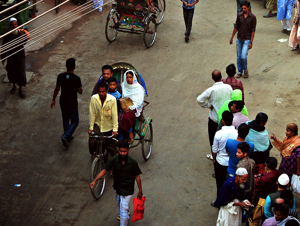 Family on a rickshaw at Old Dhaka in Bangladesh.