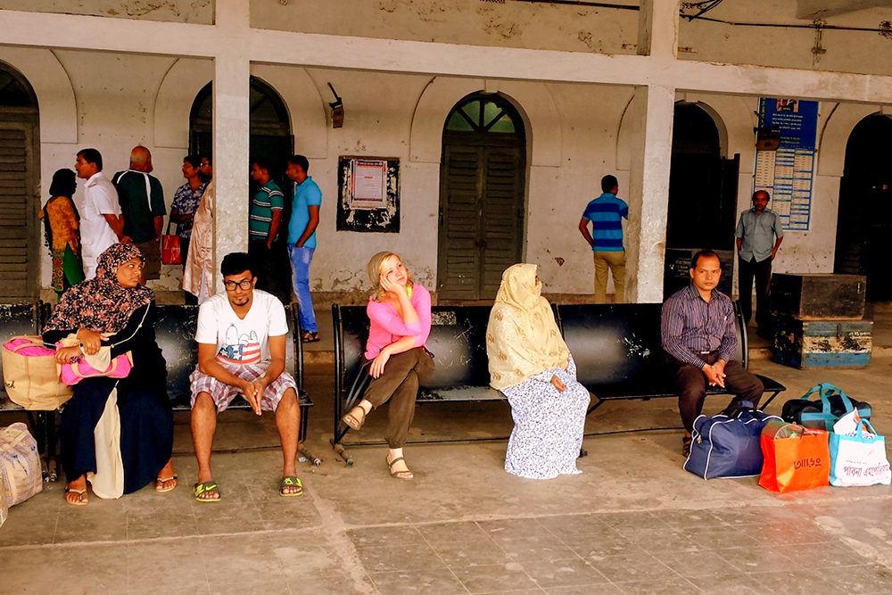 Waiting for train in a train station in Bangladesh.